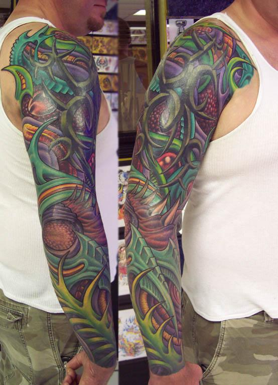 Tribal Tattoo With Color: Biomechanical Sleeve With Demensional Tribal Tattoo